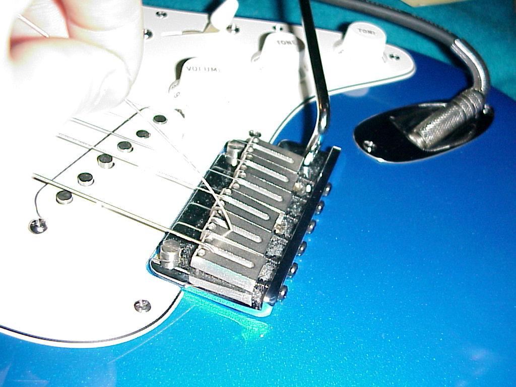 restringing a guitar